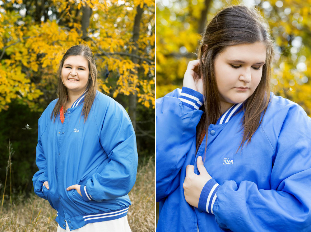 brunette senior girl in a blue jersey jacket her dad used to wear
