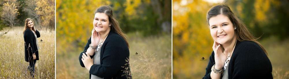 brunette senior girl in a black cardigan standing in fall foliage