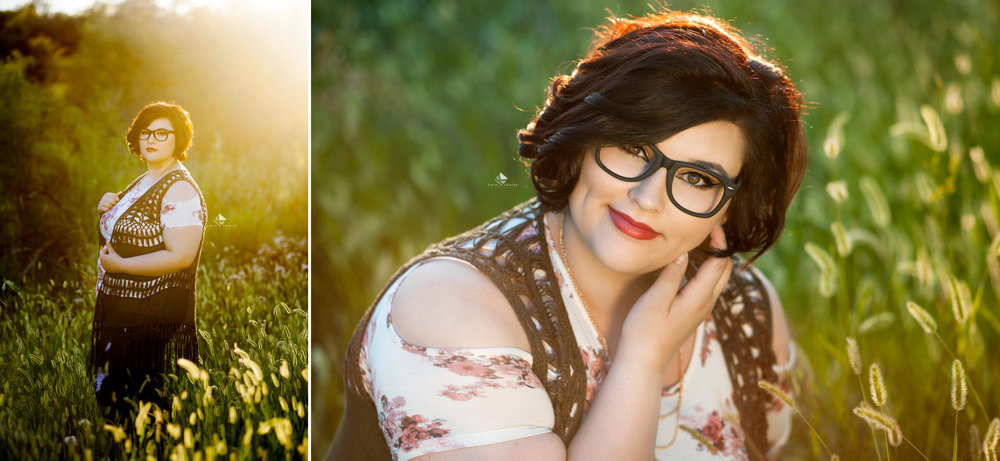 brunette senior girl in glasses in a floral off the shoulder top and a crocheted olive green vest sitting in a green tall grass field