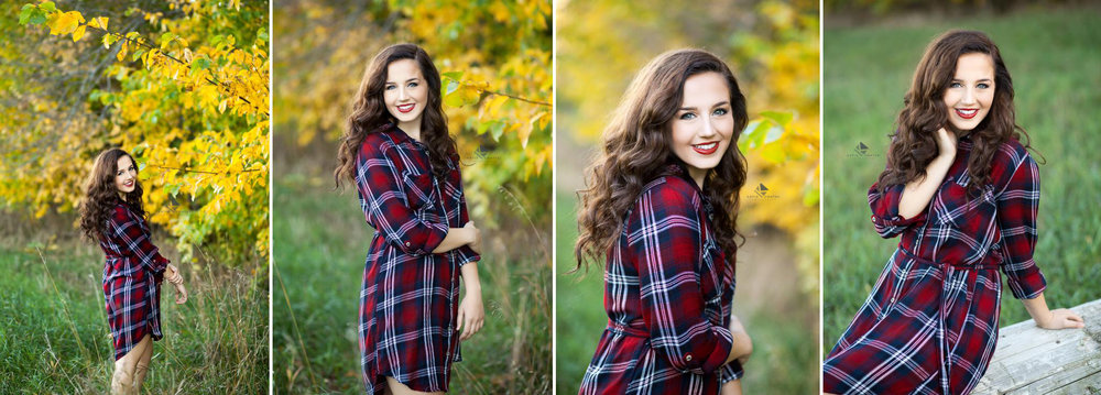 brunette senior girl in a burgundy, blue and white plaid dress standing in yellow fall foliage in South Dakota