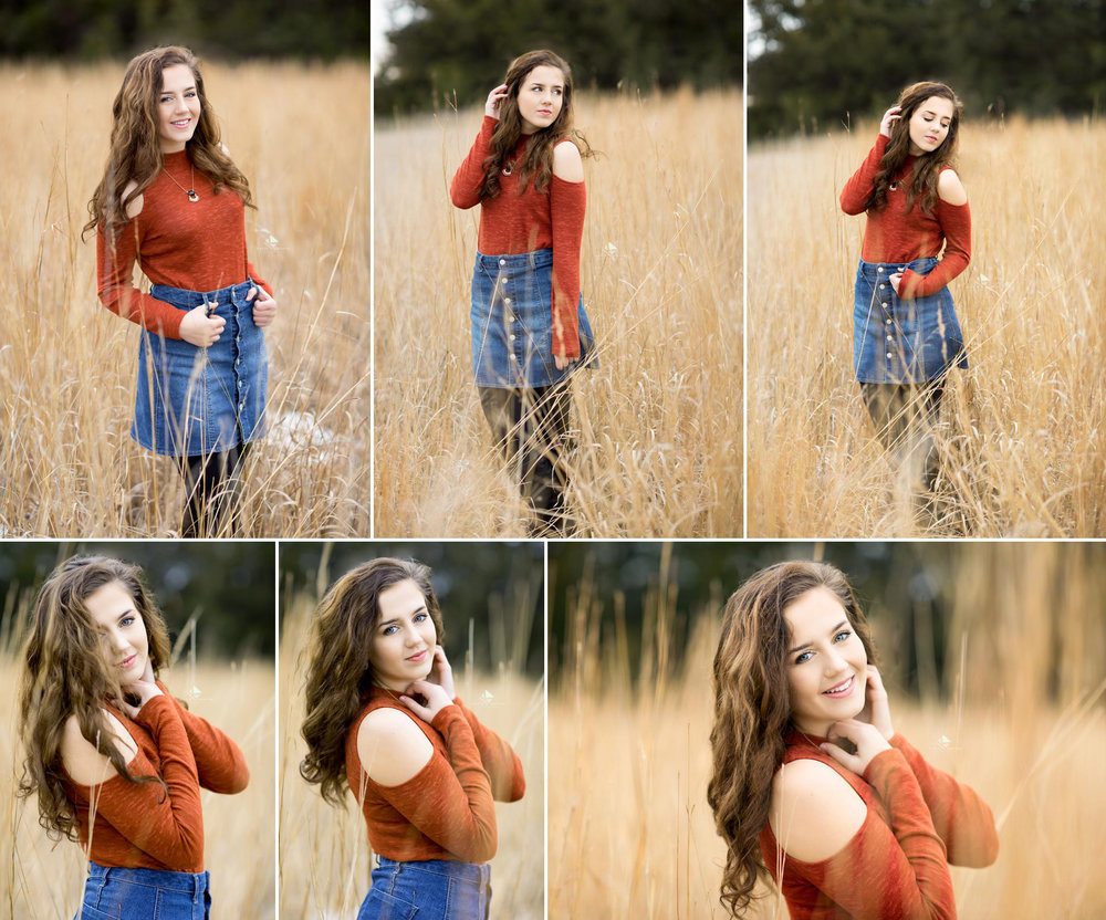 brunette senior girl in a jean skirt and an orange cold shoulder top posing in a field for senior pictures