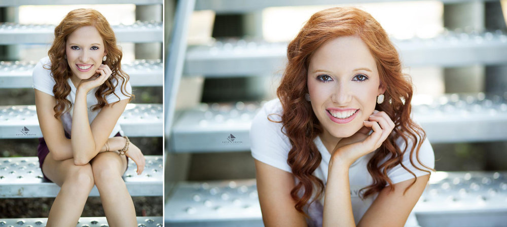 red headed senior girl in a white t shirt and maroon shorts posing for senior pictures on a set of silver stairs