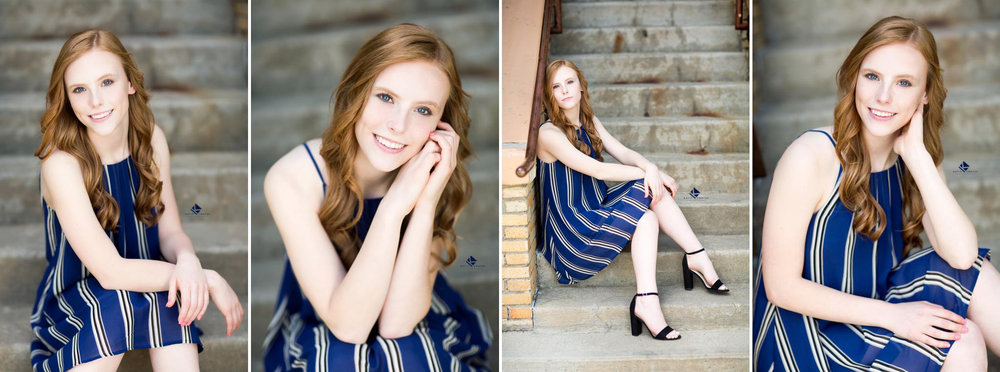 Red headed senior in a cobalt blue and white striped dress sitting on a set of cement stairs