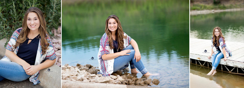brunette senior girl in a navy top, patterned cardigan with dark denim jeans posing near the water in Pickstown, SD