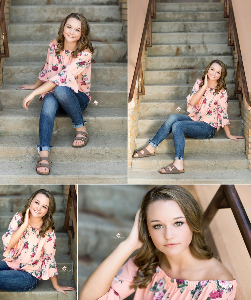 brunette senior in a peach and floral top sitting on cement stairs for senior pictures