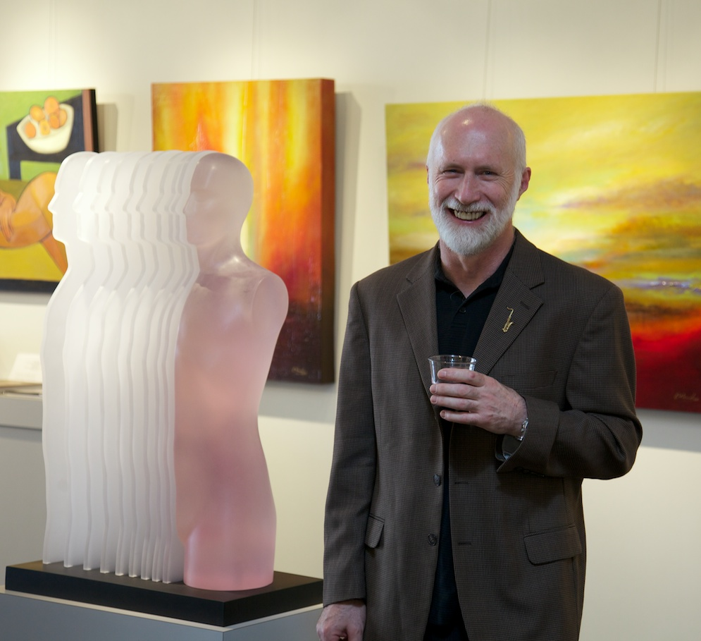 "Artist, Leonid Siveriver, with his sculpture titled ""Fade Away"""