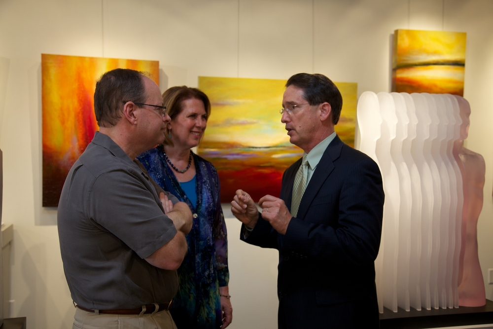 Gallery chairman, Russell Medford, gallery president, Margaret Offermann, and Director of Philanthropic Initiatives at Mission Foundation, John Locke