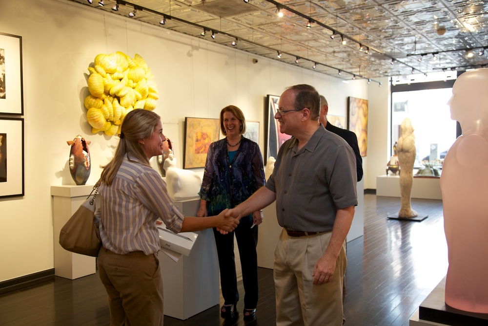 Door prize drawing with winner, Sydney Godfrey of ASID and PBI Commercial Interiors    Gallery president, Margaret Offermann, gallery director, Perry Magee, and gallery chairman, Russell Medfor