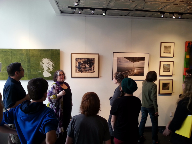Gallery Director and artist Amy Medford answers questions from middle schoolers during Students @ Work - Art & Culture Day at Artetude Gallery.