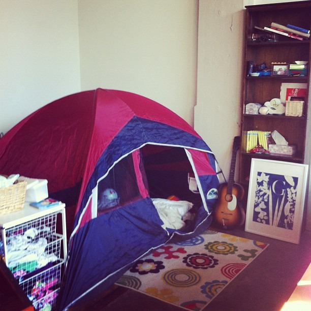 G, since we've moved into this loft you have protested sleeping. No walls equals noboundariesin your mind. So we set up this tent put your mattress in there and hung some pretty things for you to lay and gaze at. It's WORKING!   I'm 75% sold on the idea of building you a giant TeePee instead of a physical room, it will rock.
