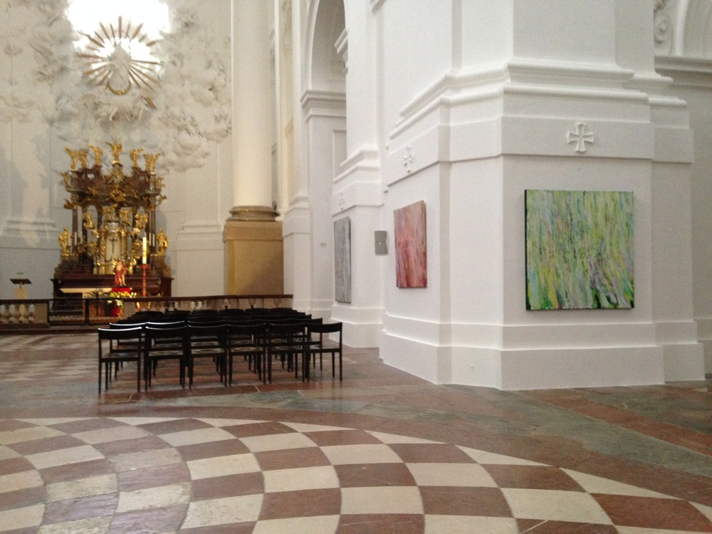 A view of the Kollegienkirche altar with Susan Swartz's Water Study 005 and Whisper of Spring II in the foreground.