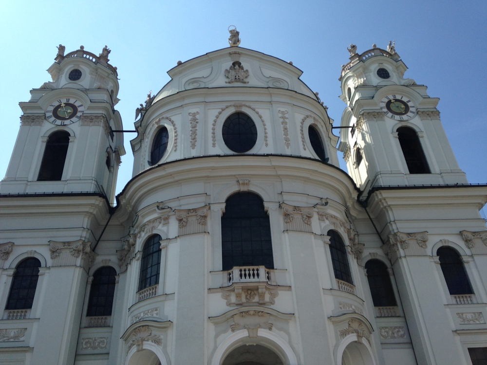 Standing outside the Kollegienkirche in Salzburg, the dramatic beauty of the architecture is striking.