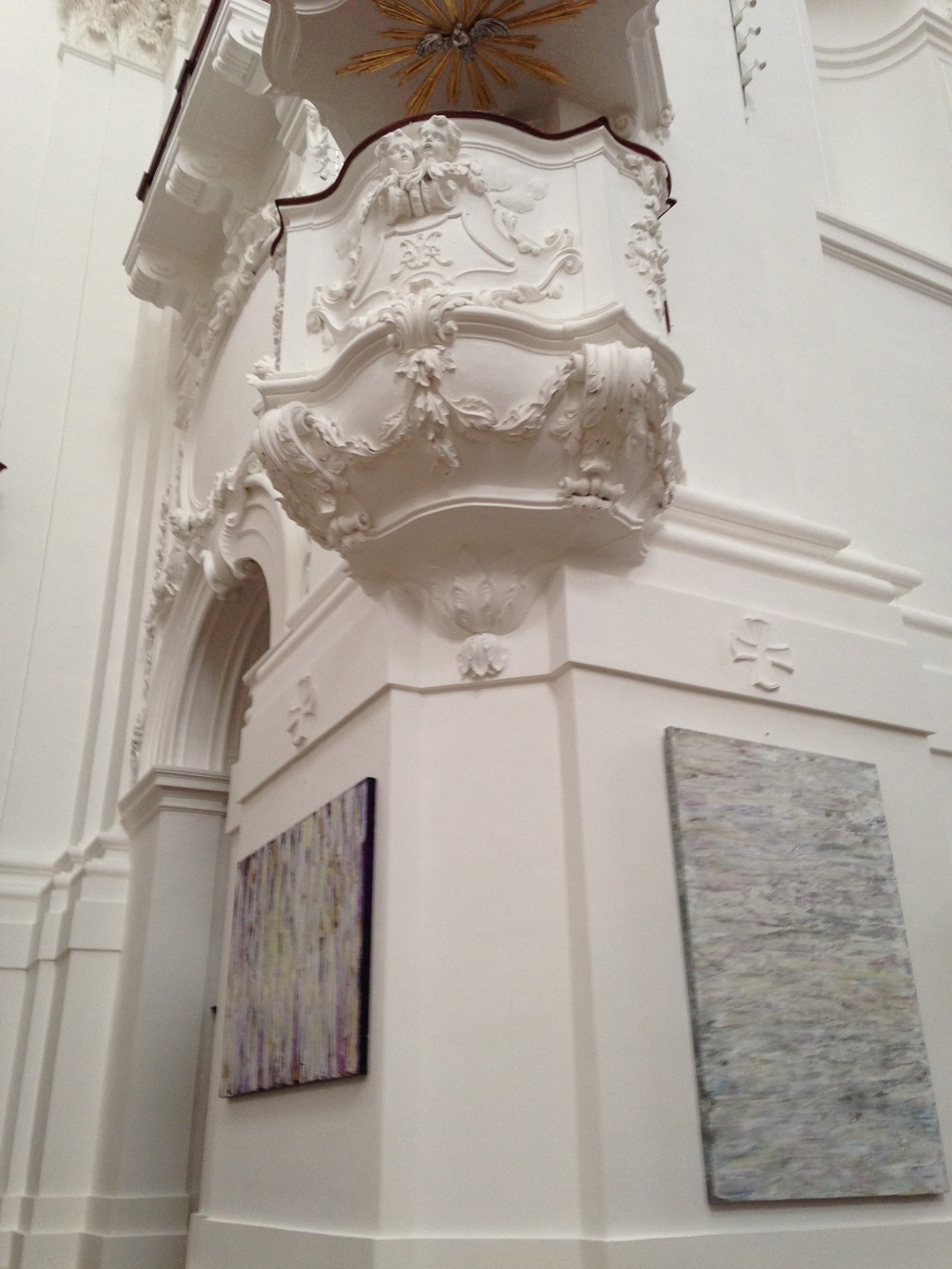 Two of Susan's more subdued paintings,  A Personal Path 2  (left) and  Quiet Interlude  (right) are displayed beneath a dramatic example of Baroque architecture.