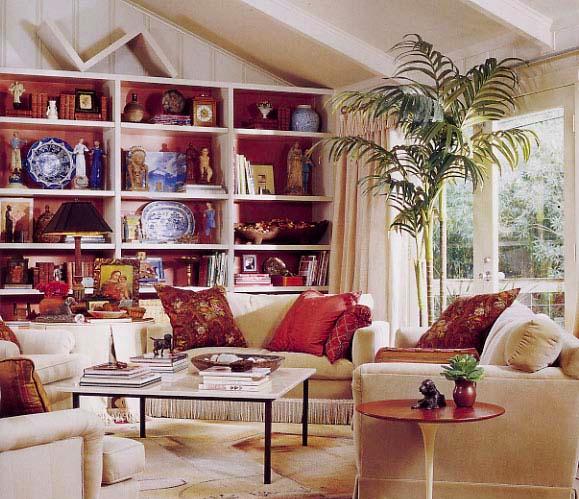 Colorful bookshelf backs,styling magazine ready interiors | Credit: Joetta Moulden