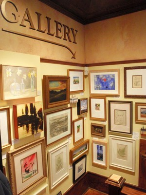 Entrance to the lower level gallery has art displayed in salon style.jpg