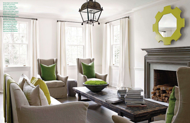 I love how the color is echoed around this room designed by Kay Douglass.