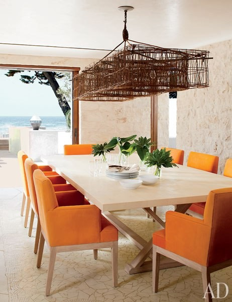 Article + Gallery ➤ http://CARLAASTON.com/designed/lighting-makes-artistic-statement When Lighting Makes A Design's Artistic Statement - Image Source: Architectural Digest (KWs: light art, chandelier, orange chair, dining room  )