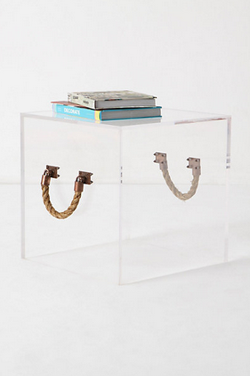 Illusion End Table | Anthropologie     - The longer version of this is called the Illusion Bench, so I'm assuming that this one would be strong enough to sit upon. Isn't this unique?   -  Nautical rope handles are the only giveaway as to the location of this sleek cube of crystal-clear Lucite.