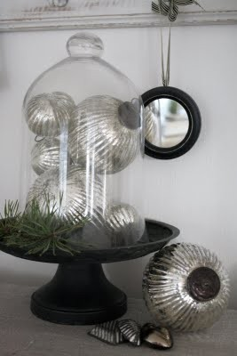Click here ➤ http://CARLAASTON.com/designed/decor-under-glass for 18 beautiful examples of the magic created when decor is placed under glass! (Image credit:anetteshus.com- KWs: ornament, silver )