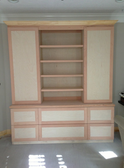 Custom cabinet for home office with file drawers and bookshelves.