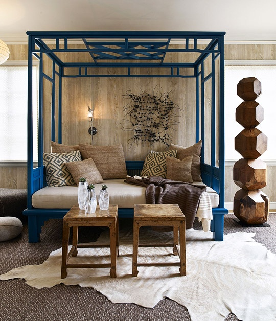 Wood paneled walls with high gloss painted chinoiserie bed | Image via:  Traditional Home , Designers:  Marion Philpotts Miller, Jonathan Staub