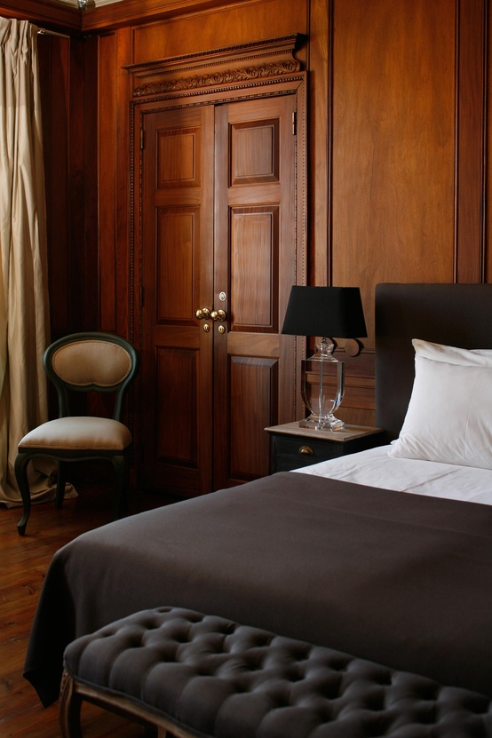 Wood paneled Guest room at  Palacio Ramahete, Lisbon