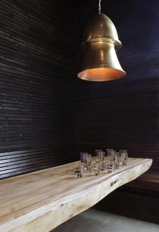 Black walls, a live edge, and brass? What more is there to love.