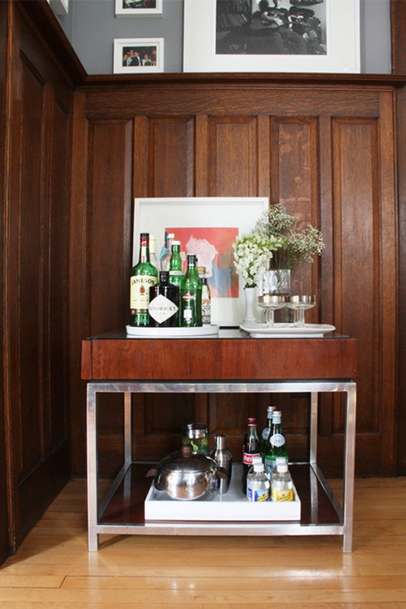 Wood paneling with bar cart | Image via:  Design Sponge