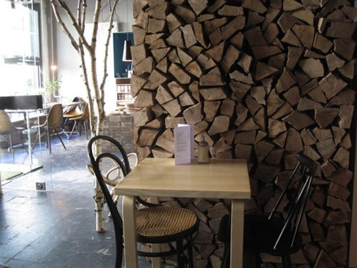 ARTICLE + GALLERY: 29 Artful Interiors Using Stacked Wood As A Design Element