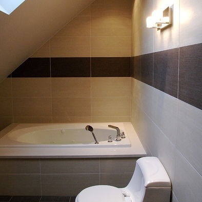 Items that can fit under a low angled ceiling a bed for Small bathroom with sloped ceiling