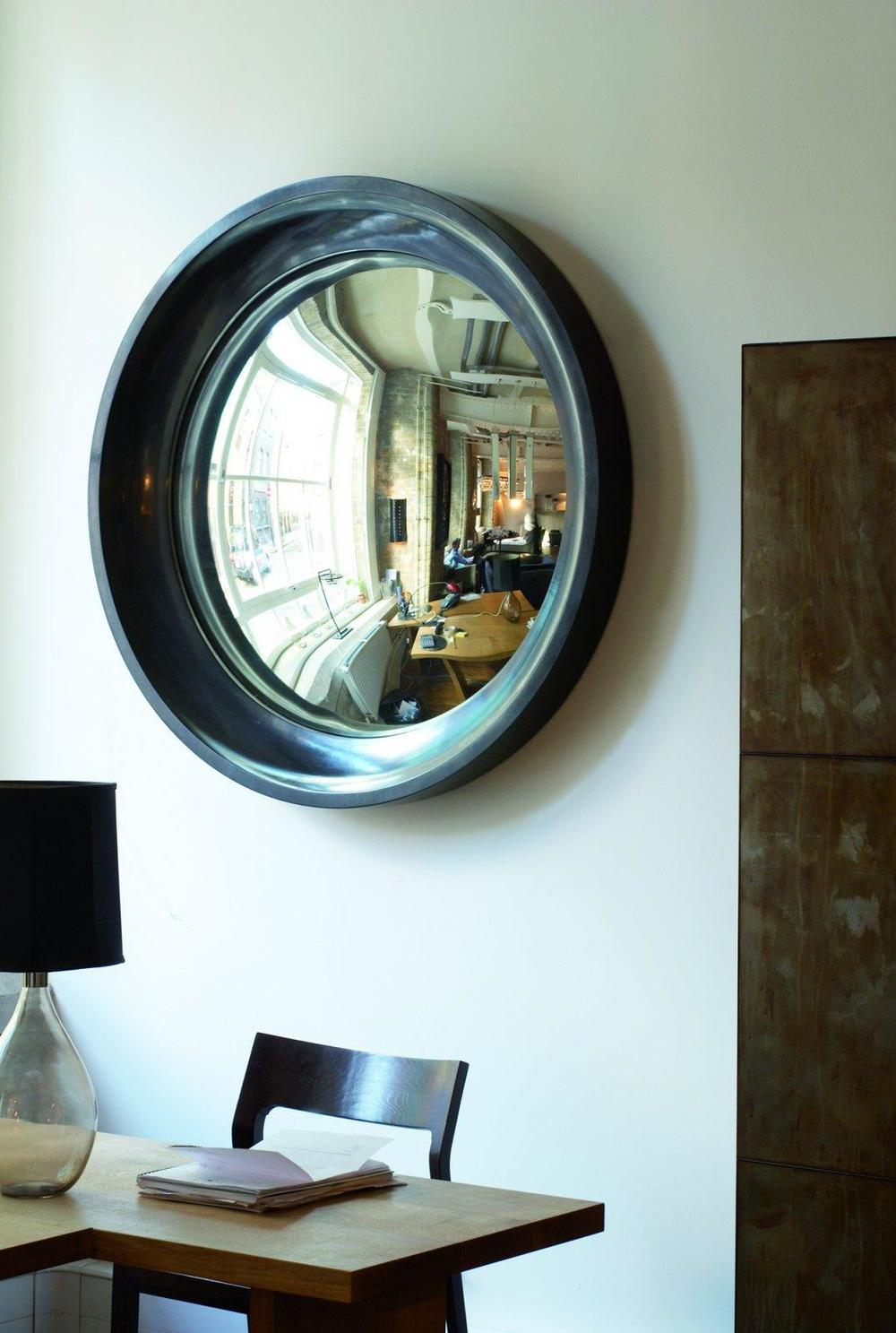 GALLERY: 15 Interiors Turned Abstract Wall Art by a Convex / Curved Mirror