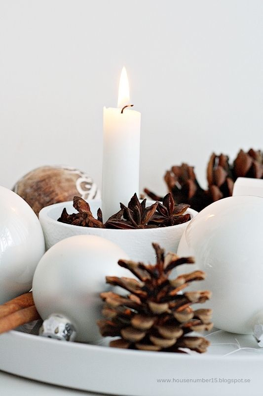 A rustic, au naturel Christmas: one that's decorated using only found natural objects and fresh greens along with some ordinary vases, baskets, and containers will gift your family with a warm, cozy Holiday season.
