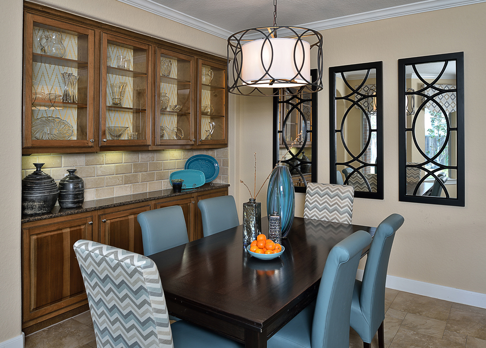 Furnishings, a new built-in entertainment center, and some finishing touches helped complete this dining room designed by Carla Aston, giving a young family a clean, contemporary look with colorful accents and fresh style that compliments personality perfectly.