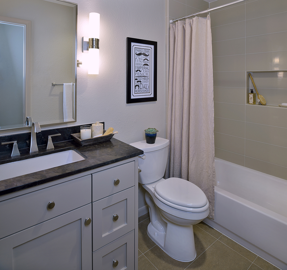 Before after a bachelor 39 s dated bathroom gets a - Small bathroom remodel with tub ...