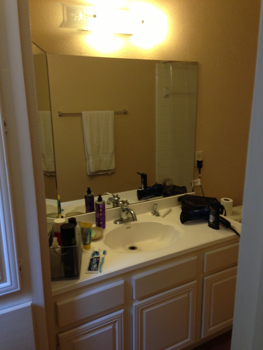 Before after a bachelor 39 s dated bathroom gets a for Bachelor bathroom ideas