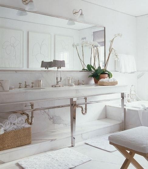 There are instances when a horizontal slab of mirror -- when done purposefully and the bathroom's overall design is kept in mind -- is the absolute best solution.