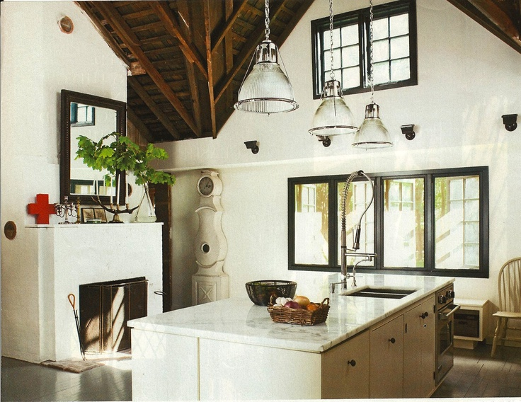 Fireplaces in the kitchen | Image via:  Elle Decor  | Homeowners: Michel Botbol of Polo Ralph Lauren and Arthur Krystofiak