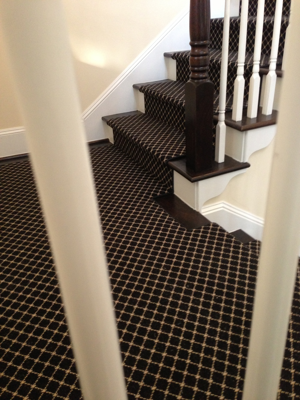 Take a look at this striking runner we installed after the Holidays on a stair in a coastal style home. Stark carpet is one of my faves. :-)