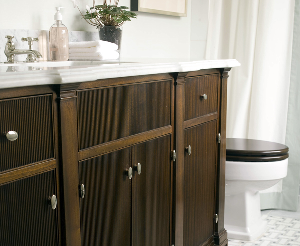In a bathroom full of cold finishes and slick surfaces, a wood seat provides that warm touch of luxury you long for.
