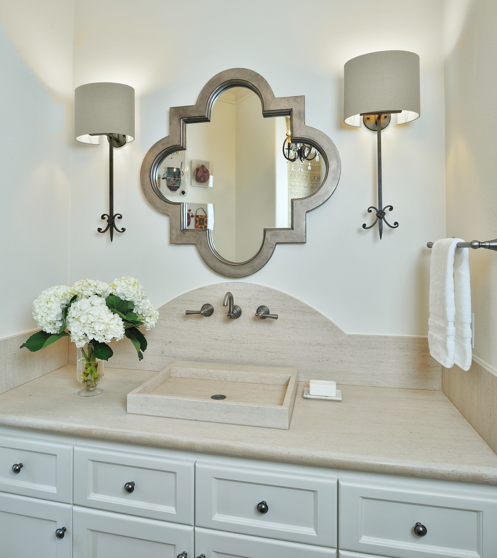 Powder Bath vanity with arched backsplash and wall mount faucet, Designer: Carla Aston