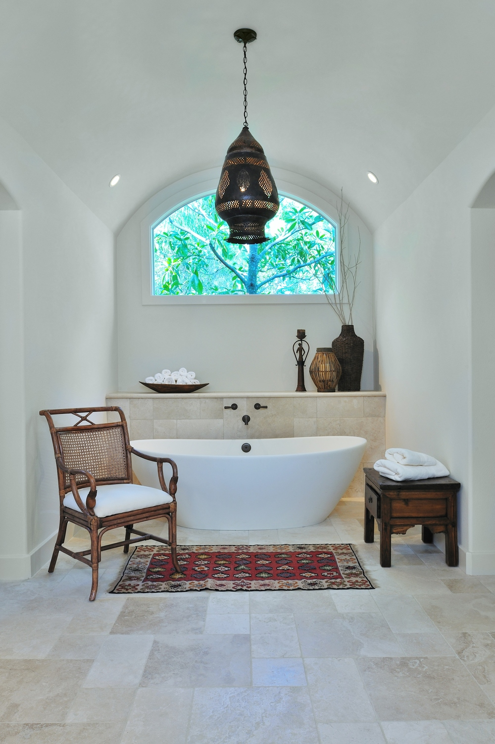Bathroom design trends |Bathroom remodel before and after with Moroccan chandelier, tile wall and ledge, barrel ceiling, free standing tub | Designer: Carla Aston, Photographer: Miro Dvorscak #bathroomideas #bathroom #tub #bathroomremodel