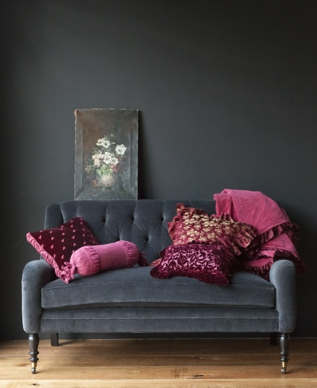 Perhaps it's the art, the pillows, the books. Whatever it may be, placing a sofa against a wall with a similar color will extend the backdrop and give even more emphasis to the contrasting items you want to stand out.