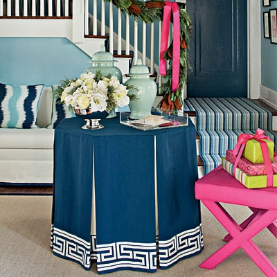 Skirted tables have a much leaner look these days and I just love it. | Interior designer: Tobi Fairley