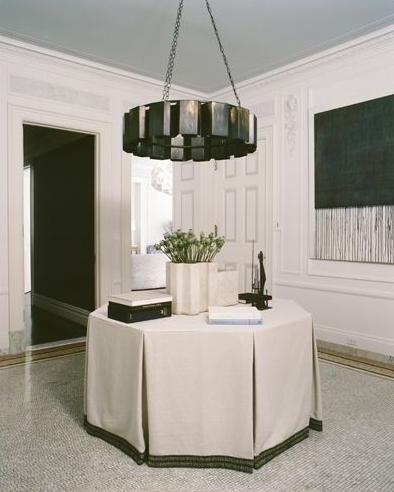 Skirted tables have a much leaner look these days and I just love it. | Interior designer: Stephen Sills