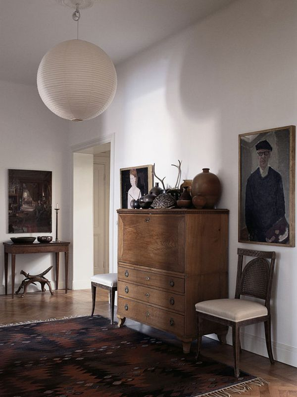 Old painted portraits will add depth and character to any room in your house. They add a sense of history and nostalgia. They add a richness and an extra layer to a room, no matter what the size. | Interior designer: Mats Gustafson