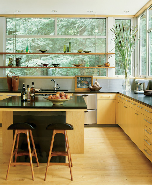Best Interior Design Links of the Week ➤ WHAT'S HOT IN THE KITCHEN? SHELVES BUILT IN FRONT OF WINDOWS | HERE'S WHY: | Shelves built in front of kitchen windows are a great solution for someone wanting to display colorful glassware or silhouette some pretty shapes of ceramics. It's not a bad spot to grow some plants either. | Interior Designer: Amy Lau Design