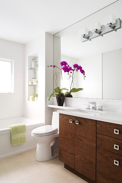 Personally, I love an exceptionally tall mirror in a space, because it adds height and feels luxurious. I love a horizontal mirror too, especially when we are trying to achieve a zen or modern look in a bathroom. | Design -er: Hicks Fine Homes