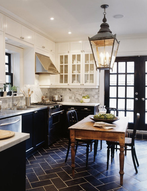 In an enclosed kitchen — a kitchen that's a separate room in the house — a center table is the best alternative to an island. | Design -er:  Tommy Smythe