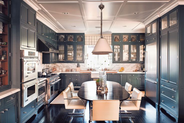 In an enclosed kitchen — a kitchen that's a separate room in the house — a center table is the best alternative to an island. | Design -er: J. Randall Powers