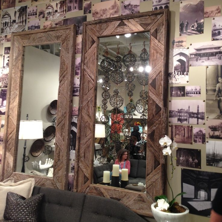 Wall decorated w/ nailheads and old photographs. At Studio A | wall decor design art